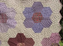 Hand-quilted, antique hexagon quilt