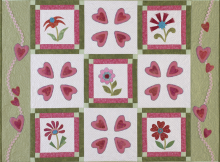 "The ""Be Mine"" quilt from the book Appliqué The basics & beyond by Janet Pittman is an adorable quilt with hearts and flowers aplenty for the season. Get the book here: http://landauerpub.com/Applique-Embroidery/Applique-The-basics-beyond.html"