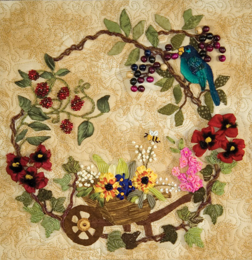 Detail of Garden Rhapsody from The Art of Elegant Hand Embroidery, Embellishment and Appliqué. Quilt designed by Lisa Christensen and Jan Vaine. Quilted by Marilyn Lange.