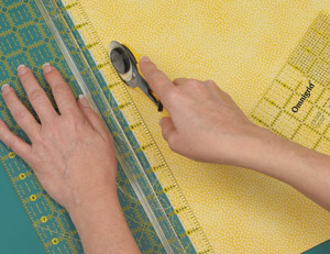 Roll the rotary cutter in a vertical position, making sure the blade does not tip to the side.